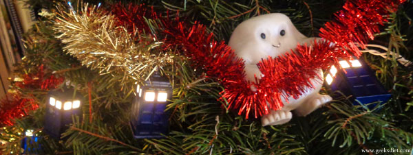 An Adipose, swinging across the Dr Who TARDIS string lights!