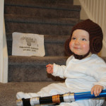 Baby wears Princess Leia Costume